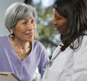 Woman talking with healthcare provider.