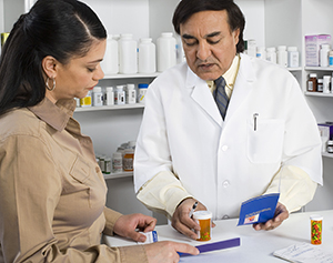 Woman consulting with pharmacist.