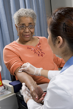 Woman having blood drawn.