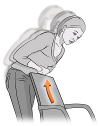 Woman bending over the back of a chair to perform choking self-rescue.