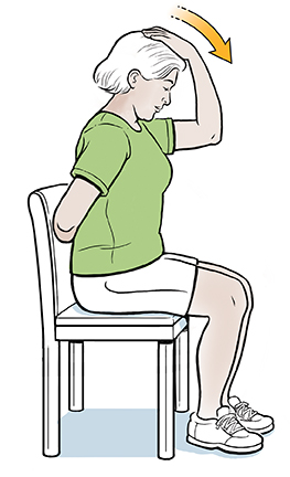 Woman sitting on chair with one hand behind back and the other on top of head, pulling it forward.