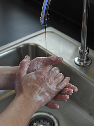 Closeup of handwashing in sink.