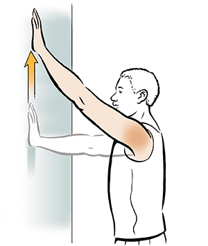 Man doing wall walk shoulder exercise.