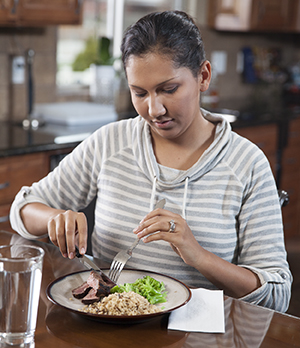 Woman eating healthy food.