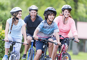 Family riding bicycles together.