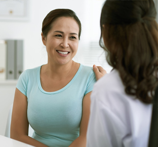Healthcare provider talking with woman patient